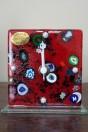 Horloge rouge en verre de Murano